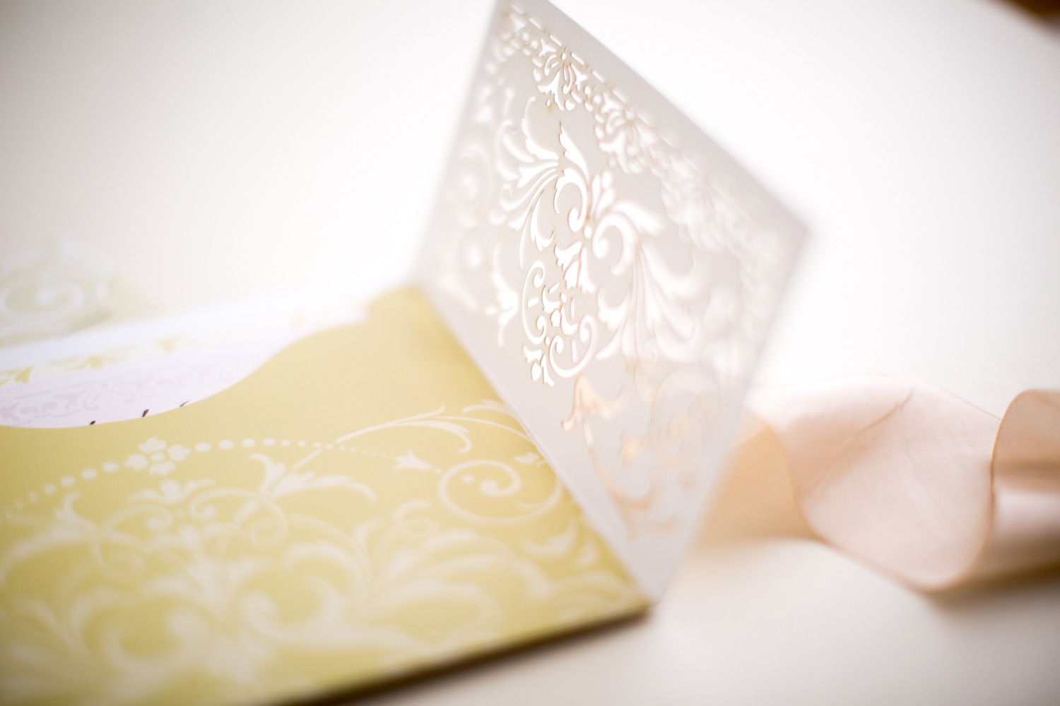 cutwork ivory and cream with gold and peach color wedding invitation