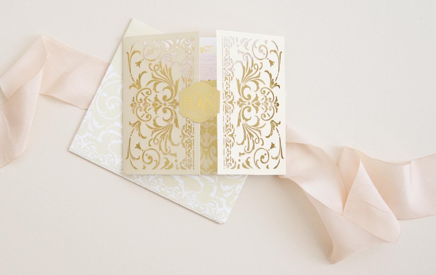gated wedding invitation with lasercut botanical design
