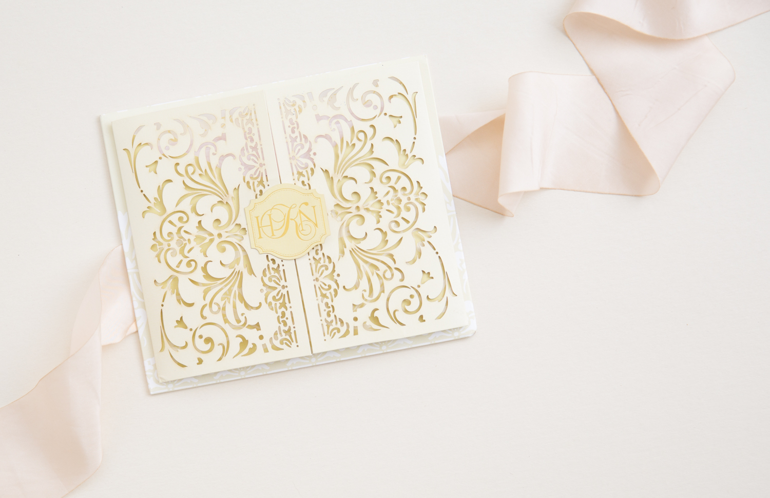 wedding invitation with ivory lasercut with gold accents