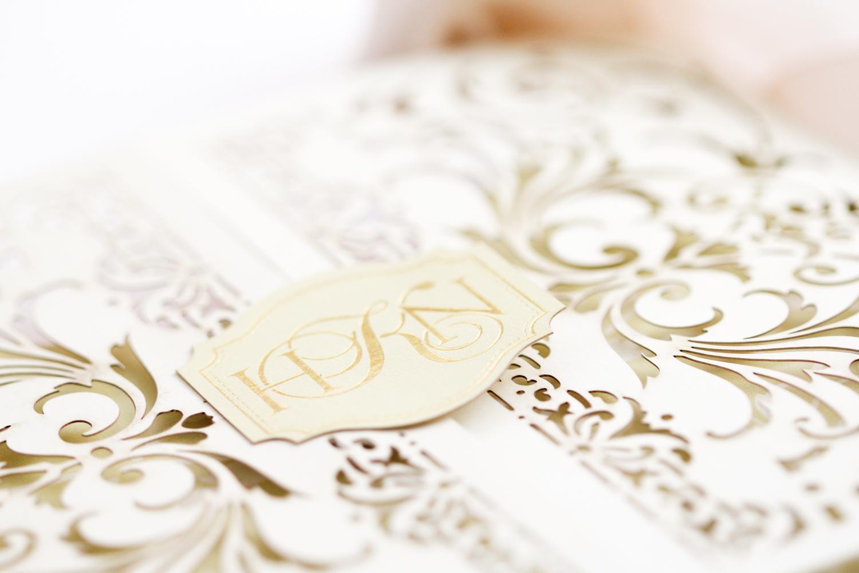 custom gold foil monogram on paper clasp