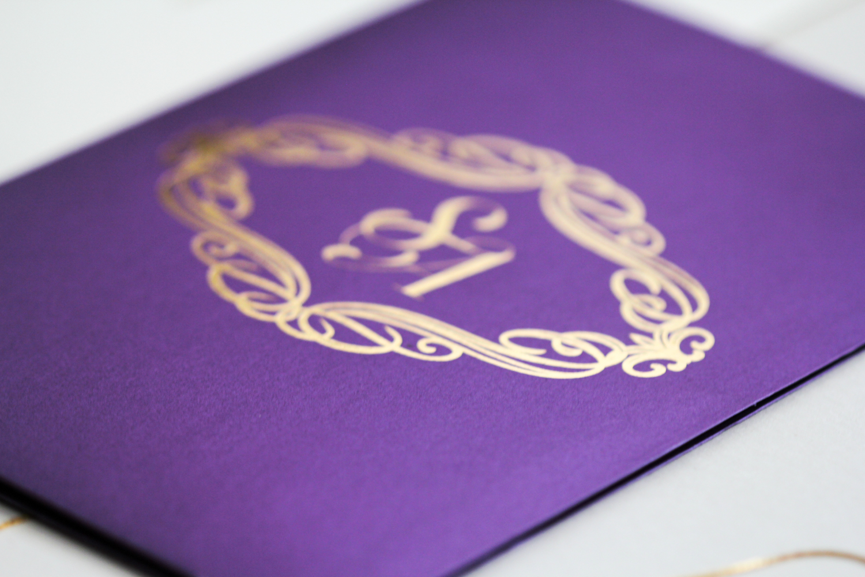 gold design invitation on purple
