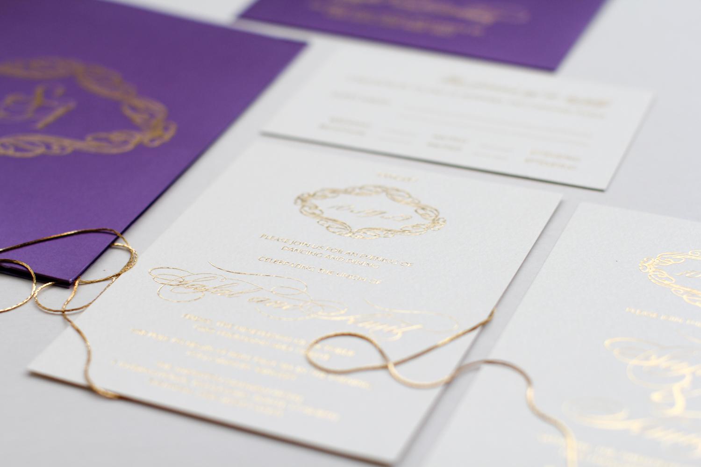 gold foil invitation with purple folio