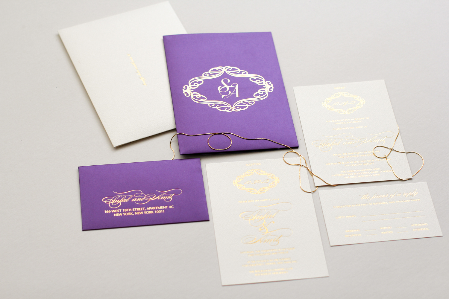 purple and gold invitation with medallion