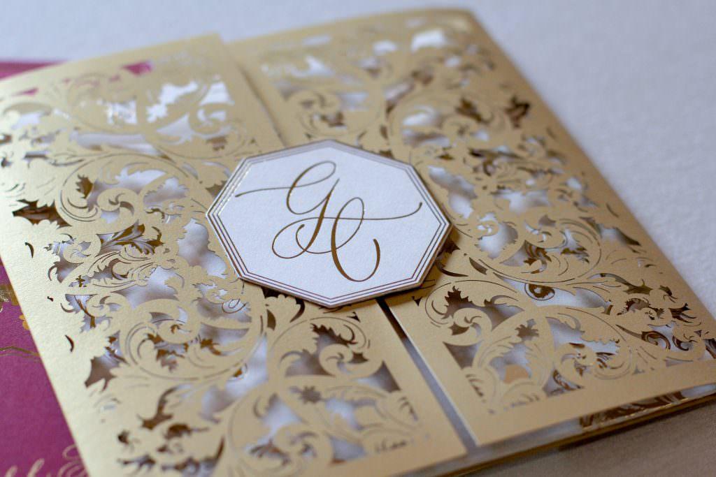 Lasercut pocket invitation with gold embossed monogram